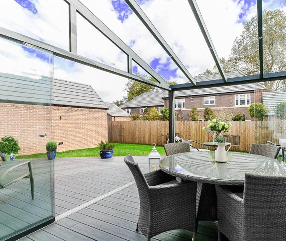 Véranda aluminium toiture verre VISION (Vitrage coulissant)